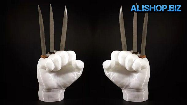 A set of steak knives with stand in the form of a fist Steak Knife Holder