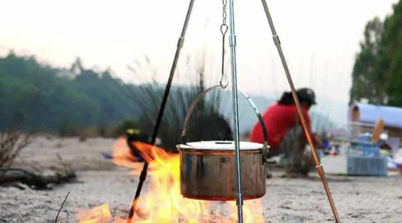 Camping tripod with hooks for cooking on the fire